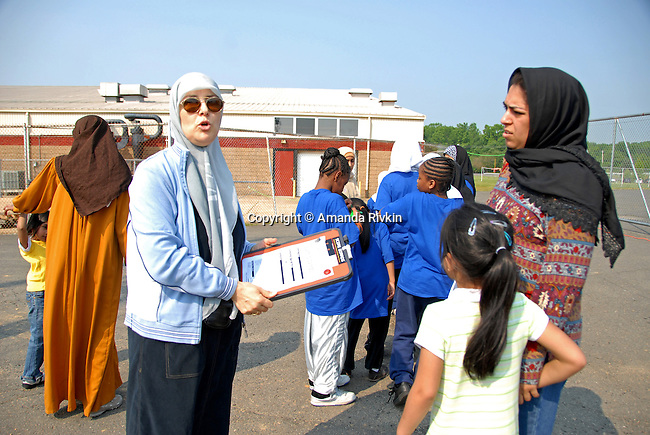A girls physical education instructor at an Islamic school in New Jersey speaks with parents and participants as the Islamic Games kicked off in South Brunswick, New Jersey on May 26, 2007.  Over 600 Muslim youths from five states participated in the event.
