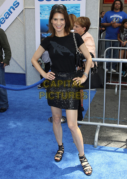 """PERREY REEVES .Arrivals - Disneynature's Premiere Of """"Oceans"""" held At El Caitan Theatre,  Hollywood, California, USA, .17th April 2010..full length black t-shirt skirt hands on hips sequined sequin bag sandals open toe strappy flats .CAP/ADM/KB.©Kevan Brooks/AdMedia/Capital Pictures"""
