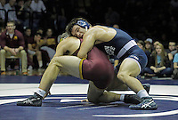 STATE COLLEGE, PA - JANUARY 25: Scott Schiller of the Minnesota Golden Gophers and Morgan McIntosh of the Penn State Nittany Lions during their match on January 25, 2015 at Recreation Hall on the campus of Penn State University in State College, Pennsylvania. Minnesota won 17-16. (Photo by Hunter Martin/Getty Images) *** Local Caption *** Morgan McIntosh;Scott Schiller