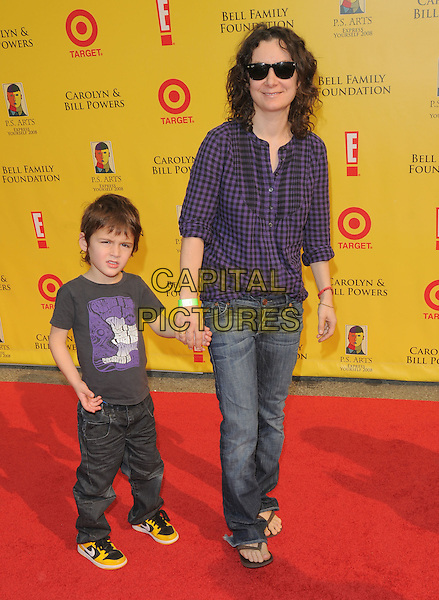 SARA GILBERT & SON LEVI .at The 2008 P.S. Arts' Express Yourself sponsored by Target held at Barker Hangar in Santa Monica, California, USA,  November 16th 2008.                                                                     .full length jeans shirt sunglasses purple black plaid checked gingham mother kid child holding hands .CAP/DVS.©Debbie VanStory/Capital Pictures