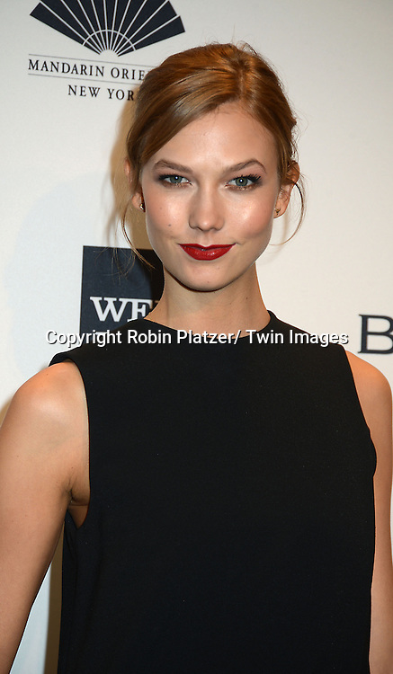 Karlie Kloss  attends the amfAR New York Gala on February 5, 2014 at Cipriani Wall Street in New York City.