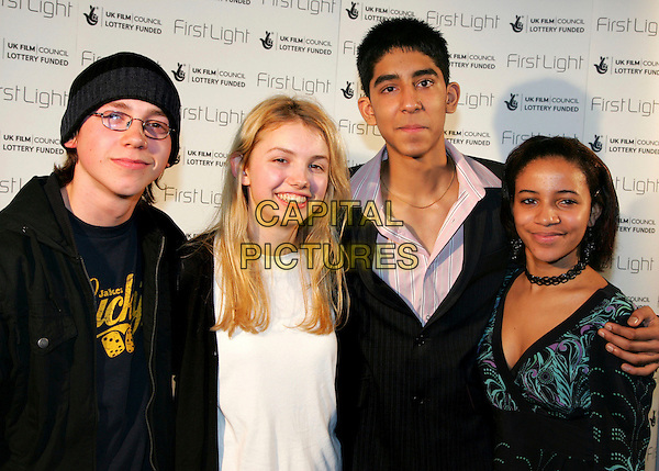 "MIKE BAILEY, HANNAH MURRAY, DEV PATEL & LARISSA WILSON.Cast members of hit Childrens TV Series ""Skins"".The First Light Film Awards, Odeon West End, London, UK. .February 27th, 2007.half length black white.CAP/ROS.©Steve Ross/Capital Pictures"