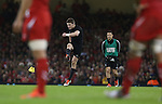 All Black outside half Beauden Barrett kicks a penalty as Dan Carter looks on.<br /> Dove men Series 2014<br /> Wales v New Zealand<br /> 22.11.14<br /> &copy;Steve Pope -SPORTINGWALES