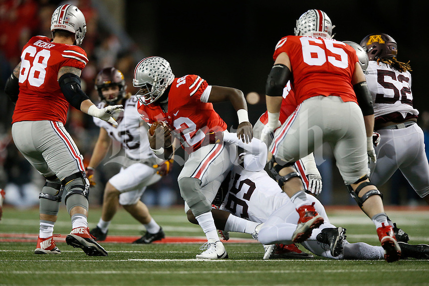 Ohio State Buckeyes quarterback Cardale Jones (12) is sacked by Minnesota Golden Gophers defensive lineman Hendrick Ekpe (95) in the first quarter of an NCAA football game between the Ohio State Buckeyes and the Minnesota Golden Gophers at Ohio Stadium on Saturday, November 7, 2015. (Columbus Dispatch photo by Fred Squillante)