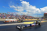 Jul, 22, 2012; Morrison, CO, USA: NHRA top fuel dragster driver Brandon Bernstein (near lane) races alongside Spencer Massey during the Mile High Nationals at Bandimere Speedway. Mandatory Credit: Mark J. Rebilas-US PRESSWIRE