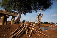 But CHANGE IS COMING... The first good road is coming into the area and the village Omorate will have the FIRST bridge in the entire valley over the Omo.  This construction worker is helping build one of the supports.  The bridge will bring lorries of tourists up from Kenya.  It will bring truck drivers delivering aid from NGOs.  The truck drivers and tourists will increase the already difficult sex tourism trade in the area.  The river will no longer supply food and the tribes of this valley will have to do other kinds of work to survive.  They will need to integrate with the culture that this new road and new bridge will bring before them.