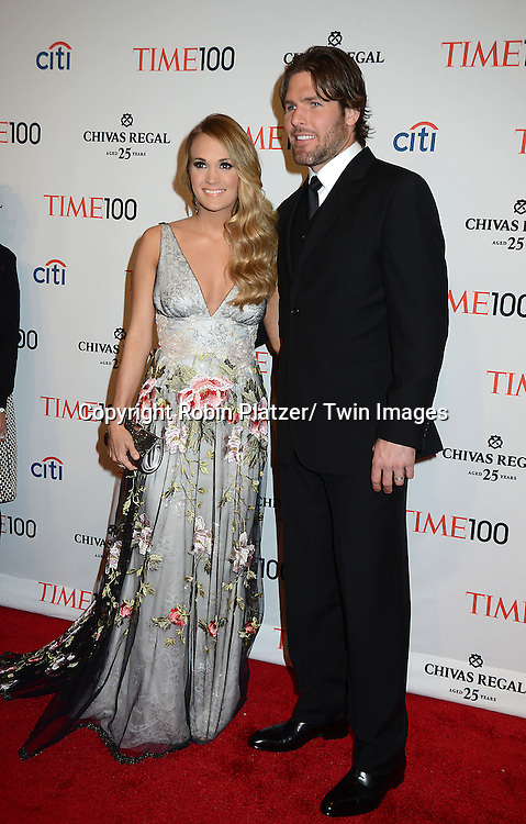 Carrie Underwood and husband Mike Fisher attend the TIME 100 Gala celebrating the 100 Most Influential People in the World on April 29, 2014 at Frederick P Rose Hall in New York City, NY, USA.