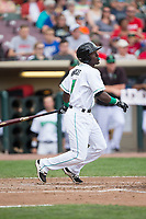 Hector Vargas (7) of the Dayton Dragons blows a bubble as he follows through on his swing against the West Michigan Whitecaps at Fifth Third Field on May 29, 2017 in Dayton, Ohio.  The Dragons defeated the Whitecaps 4-2.  (Brian Westerholt/Four Seam Images)