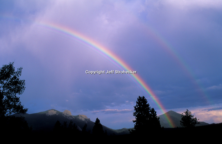 Double rainbow over mountains south of Nederland, Colorado.