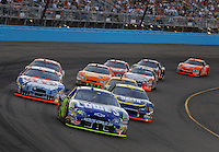 Apr 22, 2006; Phoenix, AZ, USA; Nascar Nextel Cup driver Jimmie Johnson of the (48) Lowes Chevrolet Monte Carlo leads a pack of cars during the Subway Fresh 500 at Phoenix International Raceway. Mandatory Credit: Mark J. Rebilas-US PRESSWIRE Copyright © 2006 Mark J. Rebilas..