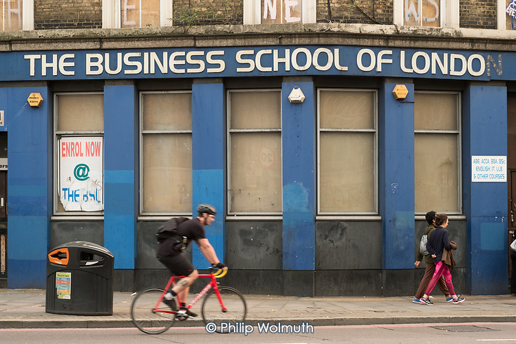 The Business School of  London.  Closed private tuition centre, Bishopsgate, City of London. Older buildings in the area are being demolished to make way for luxury residential and office towers.