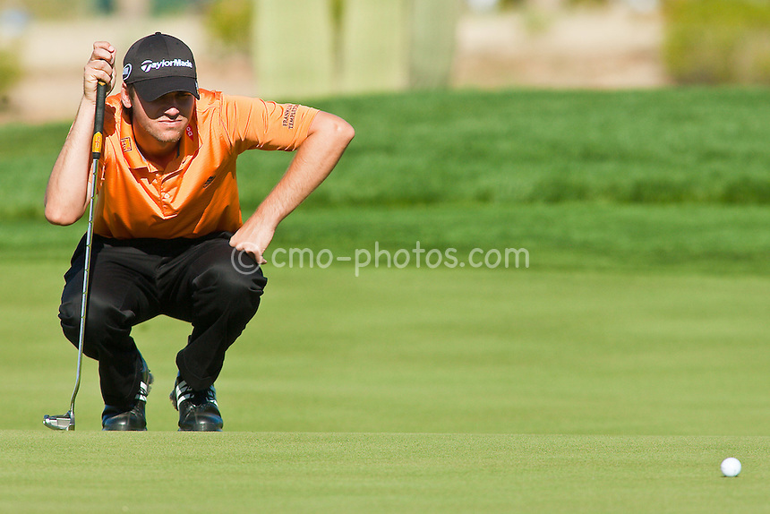 Feb 28, 2009; Marana, AZ, USA; Sean O'Hair (USA) examines a putt during the quarterfinal round of the World Golf Championships-Accenture Match Play Championship at the Ritz-Carlton Golf Club, Dove Mountain.