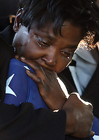 Cheryl Greenlee cries as she holds the flag presented to her at her son, Pfc. Satieon Greenlee's, gravesite Thursday at Piney Grove Baptist Church in Sandy Springs. Mr. Greenlee, from Pendleton, was one of four American soldiers killed in Baghdad on Oct. 2.