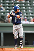 Shortstop Jose Gomez (4) of Asheville Tourists bats in a game against the Greenville Drive on Wednesday, May 3, 2017, at Fluor Field at the West End in Greenville, South Carolina. Greenville won, 8-0. (Tom Priddy/Four Seam Images)