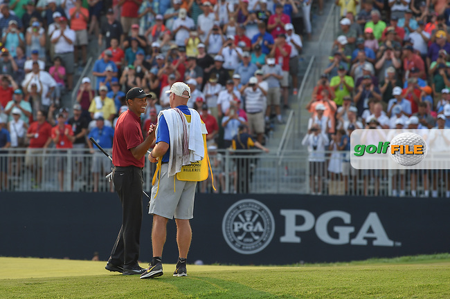 Tiger Woods (USA) sinks his birdie putt on 18 to claim second place following 4th round of the 100th PGA Championship at Bellerive Country Club, St. Louis, Missouri. 8/12/2018.<br /> Picture: Golffile | Ken Murray<br /> <br /> All photo usage must carry mandatory copyright credit (© Golffile | Ken Murray)