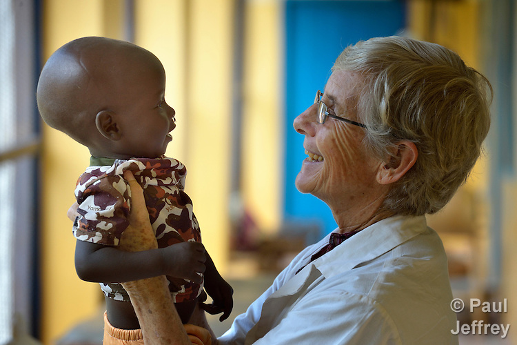 Sister Dorothy Dickson, a member of Sisters of Our Lady of the Missions, visits with a small child in the Wau Teaching Hospital in Wau, South Sudan. Dickson, from New Zealand, is director of the Catholic Health Training Institute in Wau, which trains nurses and midwives in the newly independent country. The Institute is coordinated by Solidarity with South Sudan, an international consortium of more than 200 religious congregations that trains teachers, health workers and pastoral personnel in several locations throughout South Sudan.