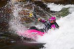 World champion freestyle kayaker Emily Jackson competes at the Reno Riverfestival 2014 freestyle kayaking
