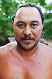 FRENCH POLYNESIA, Moorea. Portrait of man after swimming in the ocean.