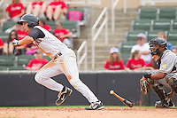 Ross Wilson #2 of the Kannapolis Intimidators takes off for first base during the game against the West Virginia Power at Fieldcrest Cannon Stadium on April 20, 2011 in Kannapolis, North Carolina.   Photo by Brian Westerholt / Four Seam Images