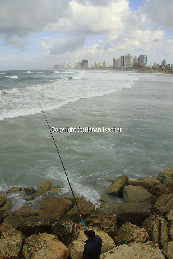 Israel, Tel Aviv-Yafo, fishing in Jaffa, Tel Aviv is in the background