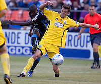 Cornell Glen (left) kicks the ball against Eric Brunner (right).The Columbus Crew defeated the San Jose Earthquakes 3-0 at Candlestick Park in San Francisco, California on August 8, 2009.