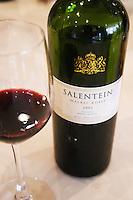 In the Sheraton Hotel Restaurant Bottle and glass of Salentein Malbec Roble Oak barrel aged 2003 Valle de Uco, Mendoza. Mendoza, Argentina, South America