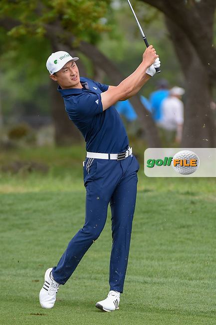 HaoTong Li (CHN) hits his approach shot on 1 during day 1 of the Valero Texas Open, at the TPC San Antonio Oaks Course, San Antonio, Texas, USA. 4/4/2019.<br /> Picture: Golffile   Ken Murray<br /> <br /> <br /> All photo usage must carry mandatory copyright credit (© Golffile   Ken Murray)