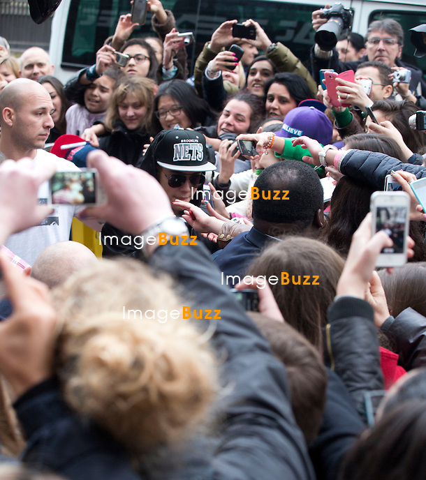 """EXCLUSIVE PHOTOS - Justin Bieber touring in Belgium - Justin Bieber arrived from France in Belgium-Brussels,  on April 9th at 4 am with his black/grey touring bus """"  Beat the streets """"..He checked into the  """" Steigenberger """"  hotel in Brussels. A few hours later, his fans were surrounding the front and back entrance of his hotel, that the security of the hotel could not handle such a craziness and had to get some big help from the brussels police. About 40 police officers arrived to surround the hotel to protect the star who had two concerts in the city of Antwerp. But Justin asked the police to leave, which they did after a while!! Justin kept hiding in the hotel between the fitness center kept opened only for him, as well the swimming pool where he did some water polo with his musicians. The bar of the hotel even got closed to the guests of the hotel around 6pm, to let justin enjoying the bar. On the first day of his concert, Justin escaped his fans by jumping from his Mercedes van into his tour bus, hided by his bodyguards. Justin's musicians even played the piano at the piano bar  of the hotel, singing Elton John's songs! It's only on his 3rd and last day in Brussels  ( April11th ) that Justin Bieber finally agreed to meet with his fans on the street. Brussels, April 10th & 11th, 2013..Pictured : fans waiting for Justin Bieber in front of his Brussel's hotel"""