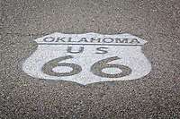 Oklahoma US Route 66 shield painted on the road in Commerce .