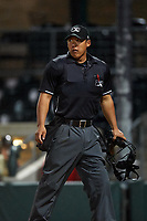 Home plate umpire Kai Nakamura during a Pioneer League game between the Grand Junction Rockies and Billings Mustangs at Dehler Park on August 15, 2019 in Billings, Montana. Billings defeated Grand Junction 11-2. (Zachary Lucy/Four Seam Images)