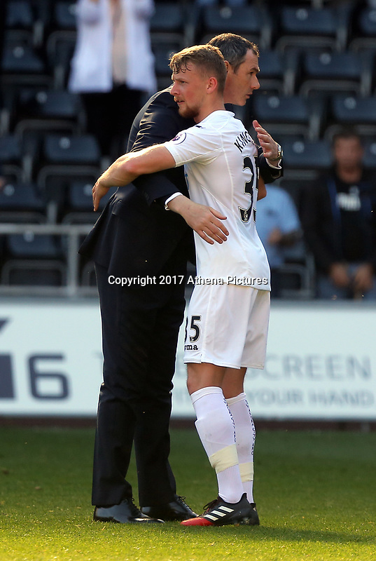 SWANSEA, WALES - APRIL 22: Manager of Swansea City, Paul Clement embraces Stephen Kingsley of Swansea City after the Premier League match between Swansea City and Stoke City at The Liberty Stadium on April 22, 2017 in Swansea, Wales. (Photo by Athena Pictures/Getty Images)