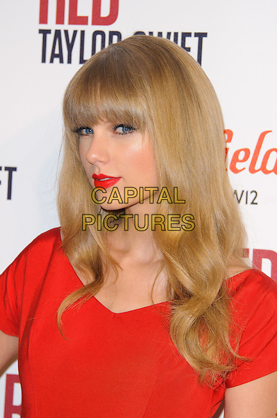Taylor Swift.at Westfield London shopping centre to switch on Christmas Lights. England..6th November 2012.headshot portrait red lipstick.CAP/CJ.©Chris Joseph/Capital Pictures.
