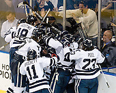 The Bulldogs celebrate their overtime win. - The Yale University Bulldogs defeated the Air Force Academy Falcons 2-1 (OT) in their East Regional Semi-Final matchup on Friday, March 25, 2011, at Webster Bank Arena at Harbor Yard in Bridgeport, Connecticut.
