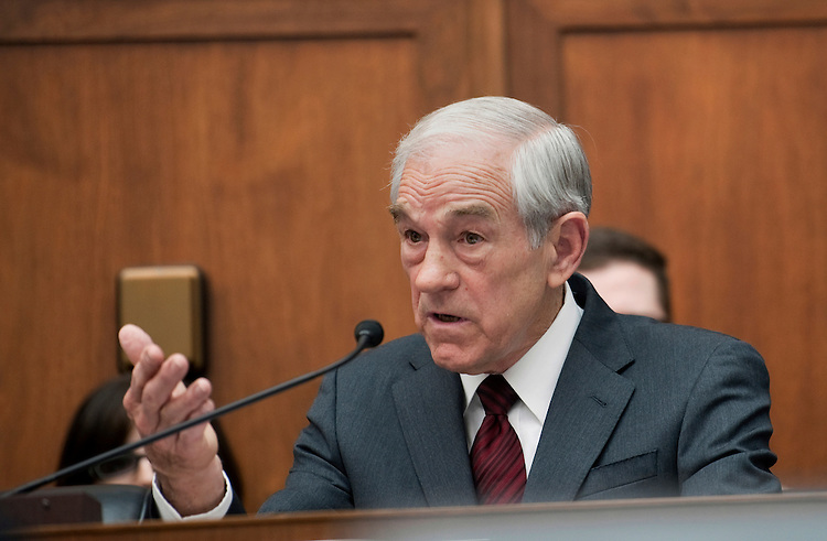 """UNITED STATES - FEBRUARY 29:  Rep. Ron Paul, R-Tx., addresses Federal Reserve Board Chairman Ben Bernanke at a House Financial Services Committee committee hearing on """"Monetary Policy and the State of the Economy."""" (Photo By Chris Maddaloni/CQ Roll Call)"""