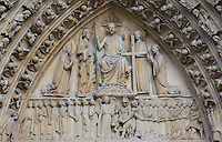 Upper lintel depicting the archangel Michael weighing the souls of the dead resuscitated from their tombs; Christ, seated on His throne of glory, showing the wounds on his hands and his side with the two angels next to him bearing the instruments of the Passion, with Mary at his right and John at his left, Portal of the Last Judgement, west façade?s central portal, 1220 ? 1230, Notre Dame de Paris, 1163 ? 1345, initiated by the bishop Maurice de Sully, Ile de la Cité, Paris, France. Picture by Manuel Cohen