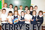 BOOKS: Reading their book on their first week at their new school Aughacasla NS Castlegregory, on Wednesday were the Junior Infants, Front l-r: David Moore, Ciara Casey, Jessy Chong, Sarah Foley, Ciara Butler, Emma Slattery and Mikey Moynihan. Back l-r: Ciara Ferriter, Callum O'Brien, Kayla Chambers,Mark Farrell, Ciara Slattery, Lily O'Connor and Kevin O'Donnell.