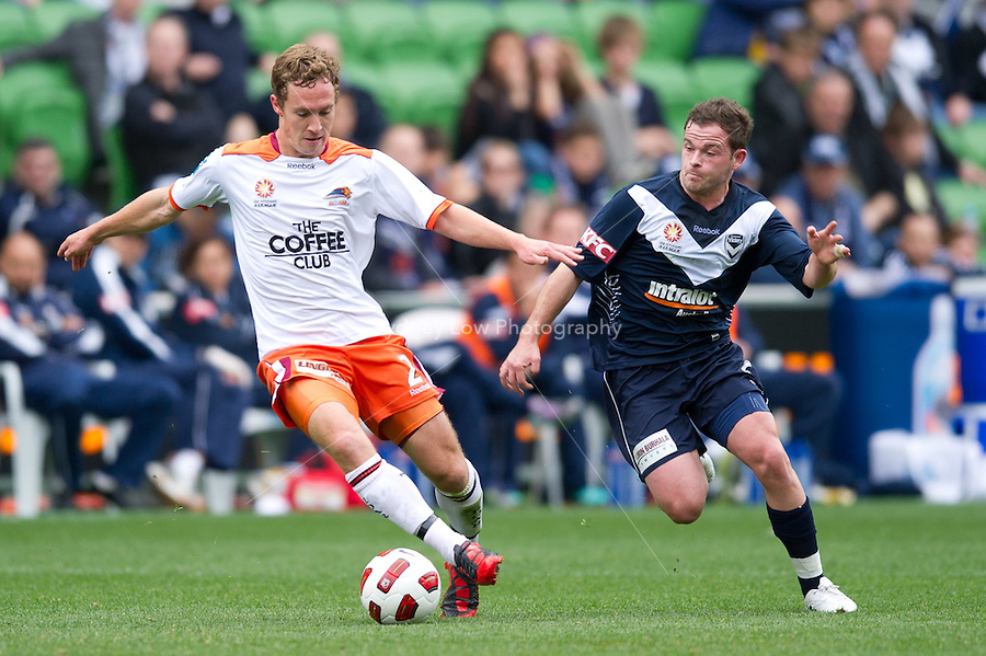 MELBOURNE, AUSTRALIA - SEPTEMBER 12, 2010: Matthew Smith from the Roar controls the ball in Round 6 of the 2010 A-League between the Melbourne Victory and Brisbane Roar at AAMI Park on September 12, 2010 in Melbourne, Australia. (Photo by Sydney Low / Asterisk Images)