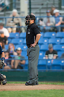 Home plate umpire Phil Bando during the Pioneer League game between the Helena Brewers and the Great Falls Voyagers at Centene Stadium on August 19, 2017 in Helena, Montana.  The Voyagers defeated the Brewers 8-7.  (Brian Westerholt/Four Seam Images)
