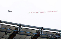 "Calcio: allenamento a porte aperte ""Open Day"" per la presentazione della Roma, a Roma, stadio Olimpico, 21 agosto 2013.<br /> An airplane carrying a banner reading ""The real truth is that we harmed you"" referring to the Italy Cup final matchwon by Lazio's city rivals, on last 26 May, during the AS Roma football club's Open Day training session at Rome's Olympic stadium, 21 August 2013.<br /> UPDATE IMAGES PRESS/Riccardo De Luca"