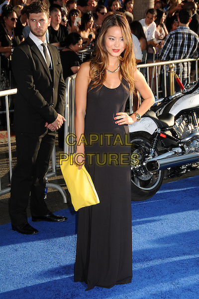 "Jamie Chung.Premiere of ""Captain America: The First Avenger"" held at The El Capitan Theatre in Hollywood, California, USA..July 19th, 2011.full length black maxi dress hand on hip yellow clutch bag.CAP/ADM/BP.©Byron Purvis/AdMedia/Capital Pictures."