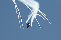 Lockheed Martin F-16 Fighting Falcon performs a display during Rygge Airshow, dropping flares. Norway