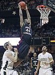 South Carolina forward Sam Muldrow (44) dunks over Vanderbilt center A.J. Ogilvy, left, and Vanderbilt forward Andre Walker (24) in the second half of an NCAA college basketball game in Nashville, Tenn., Saturday, March 6, 2010.  (AP Photo/Frederick Breedon)