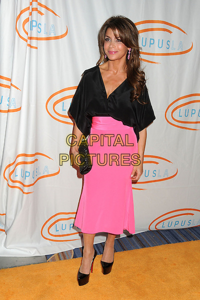 Paula Abdul.12th Annual Lupus LA Orange Ball held at the Beverly Wilshire Hotel, Beverly Hills, California, USA..May 24th, 2012.full length blouse top pink skirt clutch bag black.CAP/ADM/BP.©Byron Purvis/AdMedia/Capital Pictures.