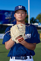 AZL Brewers Blue Jian Yi (11) poses for a photo before an Arizona League game against the AZL Athletics Gold on July 2, 2019 at American Family Fields of Phoenix in Phoenix, Arizona. AZL Athletics Gold defeated the AZL Brewers Blue 11-8. (Zachary Lucy/Four Seam Images)