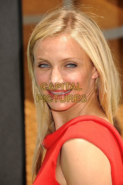 "CAMERON DIAZ.Attending the ""Shrek Forever After"" Los Angeles Film Premiere held at the Gibson Amphitheatre, Universal City, California, USA, 16th May 2010..arrivals portrait headshot make-up  lipstick red  gold hoop earrings smiling side .CAP/ADM/BP.©Byron Purvis/AdMedia/Capital Pictures."