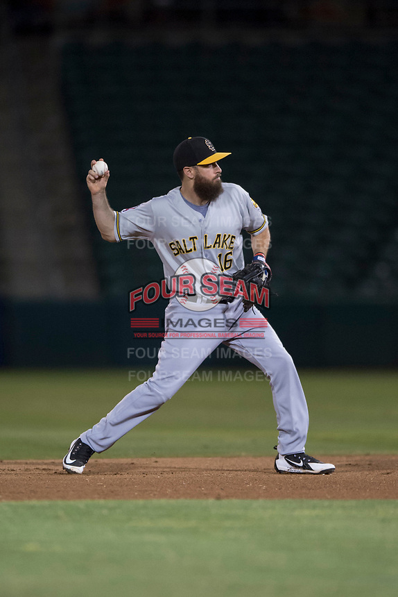 Salt Lake Bees second baseman Dustin Ackley (16) makes a throw to first base during a Pacific Coast League game against the Fresno Grizzlies at Chukchansi Park on May 14, 2018 in Fresno, California. Fresno defeated Salt Lake 4-3. (Zachary Lucy/Four Seam Images)