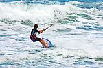 A man participates in kite surfing.