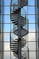 Staircase ascends up the mirrored glass walls of Perlan, the landmark building used for hot water storage.