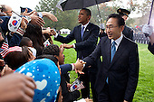 United States President Barack Obama and President Lee Myung-bak of the Republic of Korea greet guests during the State Arrival Ceremony on the South Lawn of the White House, October 13, 2011.  .Mandatory Credit: Pete Souza - White House via CNP