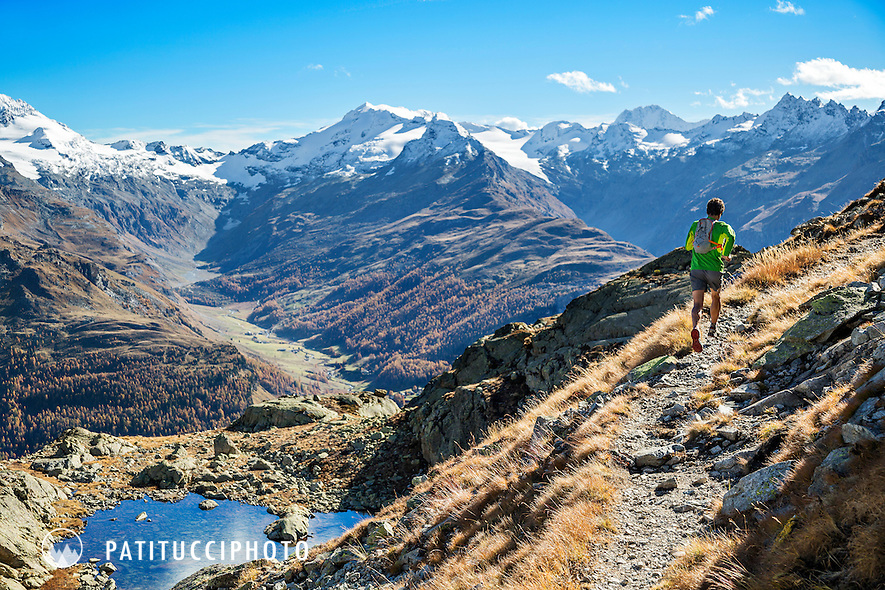 Trail running in the Engadin Valley between St. Moritz and Silvaplana. Switzerland.